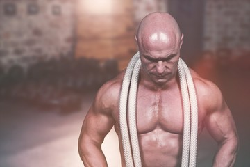 Composite image of bald man with rope around neck