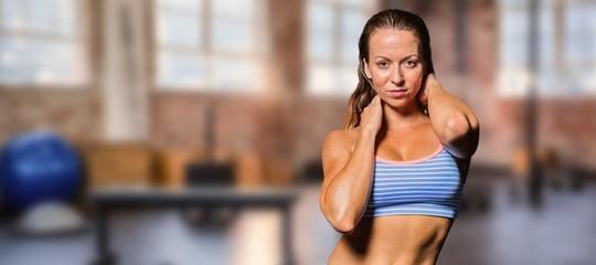 Composite image of portrait of sexy female athlete