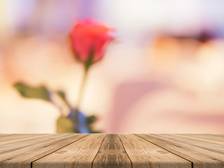 Wooden board empty table in front of blurred background. Perspective brown wood over blur beautiful roses - can be used for display or montage your products and mock up. Love concept.