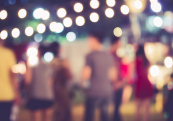 Festival Event Party with People walking Blurred Background
