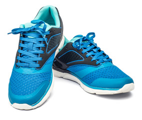 Picture of a pair of blue trainers over a white background