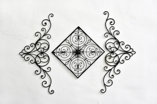 Decorative wrought iron hanging on the white wall