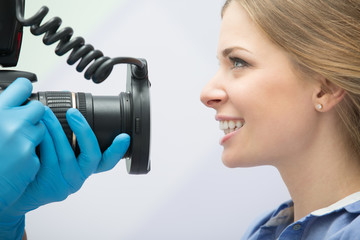 Dentist with camera and patient