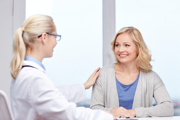 doctor talking to woman patient at hospital