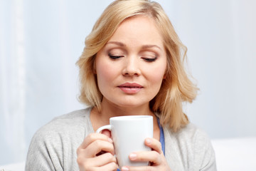 woman with cup of tea or coffee at home