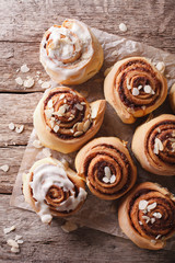 Glazed Cinnamon rolls with almond close up. vertical top view