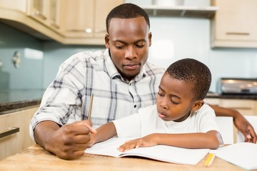 Father helping son for homework