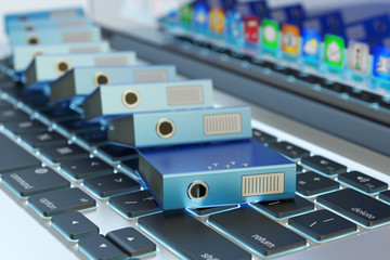 Office paperwork, computer data storage, archive documentation catalog and electronic document management concept, pile of blue ring binders on laptop keyboard