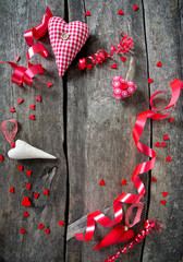 hearts and ribbons on wooden surface