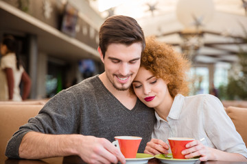 Happy couple drinking coffee in restaurant