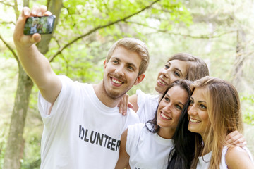 group of teenagers takes a selfie