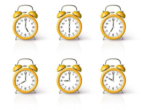 Orange ringing alarm clock isolated on white background