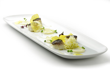 Scallops in a crust of black rice with cream of celery rapa