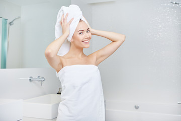 Fresh Young Woman Wrapped with Towels After Bath, Smiling at the