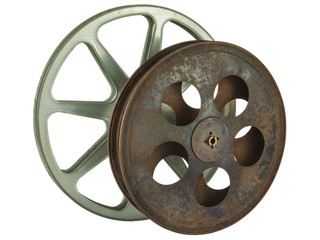 Two vintage film reels isolated on white