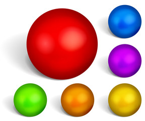 Set of multicolored spheres with shadows on white background