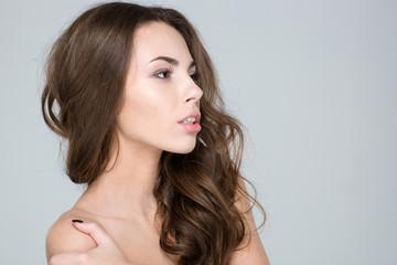 Beauty portrait of a pretty woman looking away
