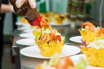 tasty appetizer. The process of filling tartlets stuffed chef restaurant. hands fill and decorate the dish. in  restaurant kitchen. Holiday Appetizers