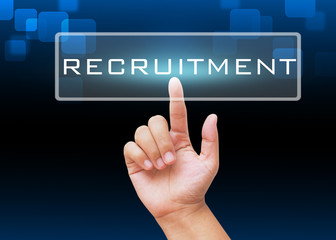 Hand pressing Recruitment button with technology background