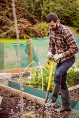 Man with a shovel gardening