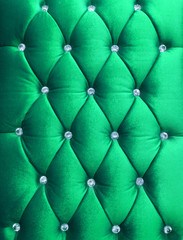 Green upholstery velveteen decorated with crystals as texture an