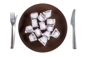 Concept picture of a plate with ice cubes, symbolizing Anorexia