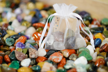 A bag colored smooth stones. Idea for the Gift. Round precious and semi-precious minerals. Polished minerals. Beautiful natural stones. Natural stones. Geology and geography. Scattering of stones.