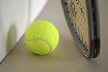 Tennis ball with racket / Tennis ball with racket on the ground.