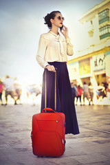 Travelling with a red suitcase