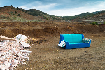 Old sofa in a landfill. Region of Murcia. Spain