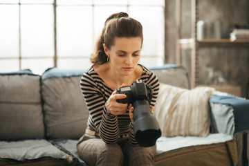 Photo of young woman with brown hair using dslr photo camera