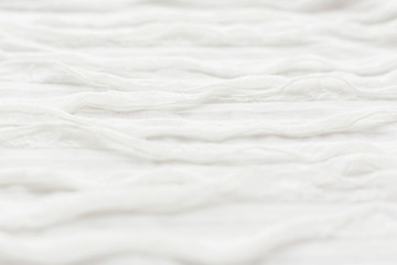 Abstract textile background. White fabric with ruche.