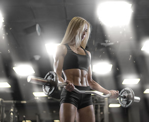 Sports young sexy girl training at the gym
