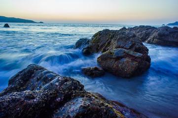 waves breaking on the rocky beach.