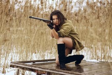 pretty girl shoting from hunting rifle