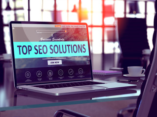 Top SEO Solutions Concept on Laptop Screen.