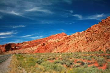 Road to Arches National Park - A Utah highway leads visitors to great wonders of red stone in Arches National Park, USA.