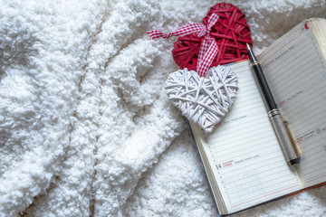 Love notebook with pen on fur background