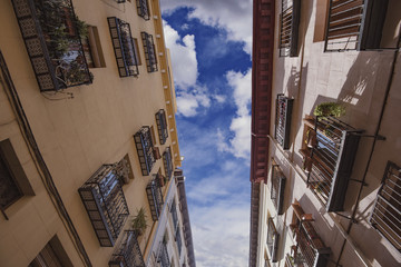Residential buildings on a narrow street in Madrid, Spain.