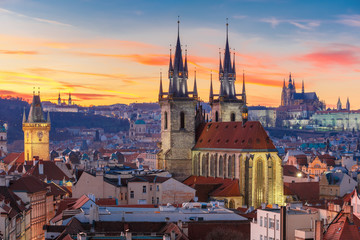 Fototapete - Aerial view over Church of Our Lady before Tyn, Old Town and Prague Castle at sunset in Prague, Czech Republic