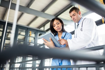 Nurse and doctor looking at a tablet