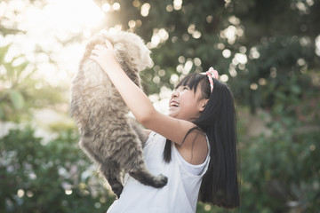 Asian girl holding Lovely persian cat
