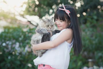 Asian girl holding Lovely persian cat