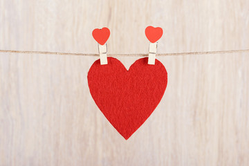 Red heart hung on the rope