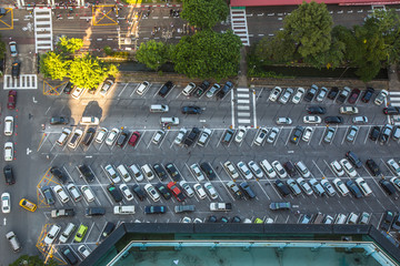 Car parking lot viewed from above in the evening