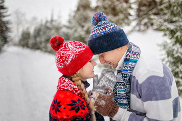 Young couple in love outdoor in winter cold weather