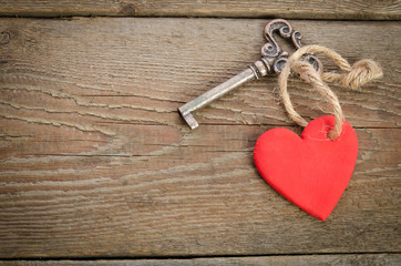 Handmade Heart with key together lying on a wooden  board.top vi