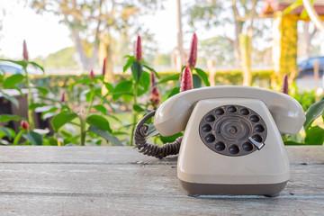 Retro telephone on wood table