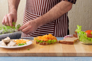 Man cooking big sandwich