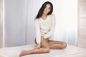 Sensual brunette woman posing .